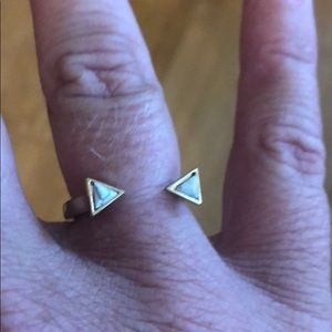 Open gold ring w/ white stone triangles